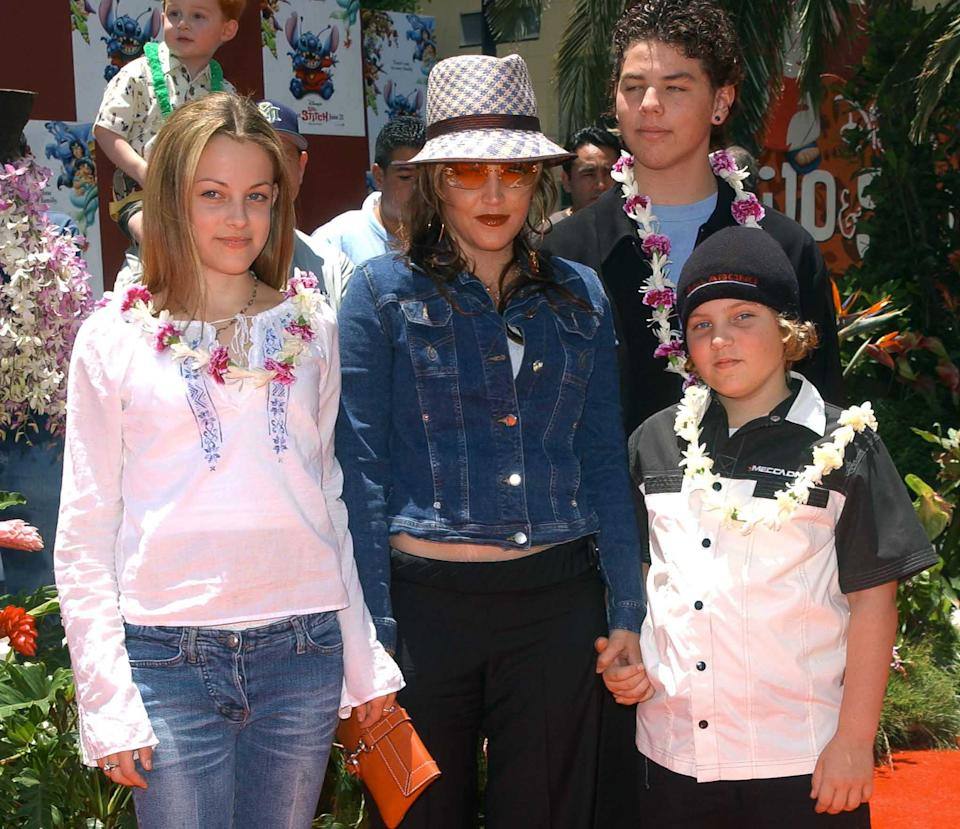 Lisa Marie Presley and her children Benjamin Keough (R),  Riley Keough (L), and her half-brother Navarone Garibaldi (back) attend the premiere of