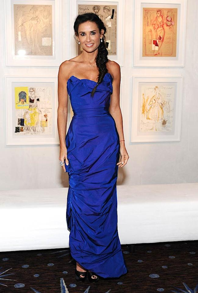 """Also in attendance at the star-studded soiree ... 48-year-old Demi Moore, who looked fabulous in a vintage Vivienne Westwood strapless dress. Simple jewelry, black peep-toes, and a braided ponytail completed her youthful outfit. Stefanie Keenan/<a href=""""http://www.gettyimages.com/"""" target=""""new"""">GettyImages.com</a> - February 22, 2011"""