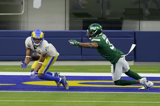Los Angeles Rams wide receiver Robert Woods, left, catches a touchdown next to New York Jets cornerback Bless Austin during the second half of an NFL football game Sunday, Dec. 20, 2020, in Inglewood, Calif. (AP Photo/Ashley Landis)