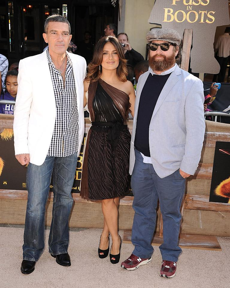 """<a href=""""http://movies.yahoo.com/movie/contributor/1800018806"""">Antonio Banderas</a>, <a href=""""http://movies.yahoo.com/movie/contributor/1800018952"""">Salma Hayek</a> and <a href=""""http://movies.yahoo.com/movie/contributor/1805534781"""">Zach Galifianakis</a> at the Los Angeles premiere of <a href=""""http://movies.yahoo.com/movie/1809796671/info"""">Puss in Boots</a> on October 23, 2011."""