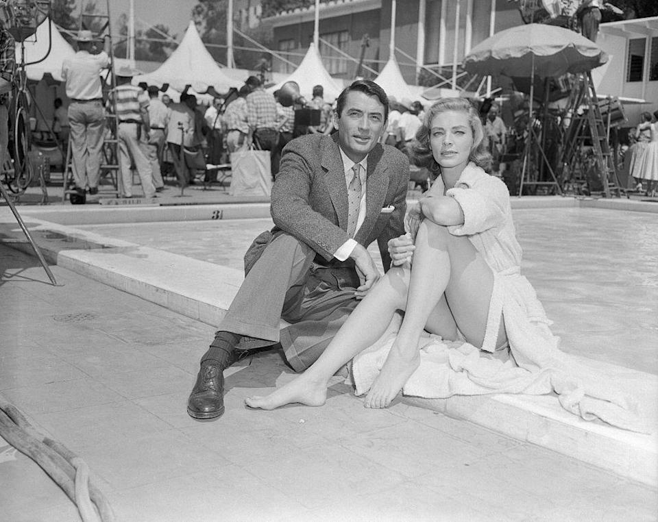 <p>Lauren Bacall and costar Gregory Peck pose by the pool at The Beverly Hills Hotel, where they filmed their 1957 film <em>Designing Woman</em>. </p>