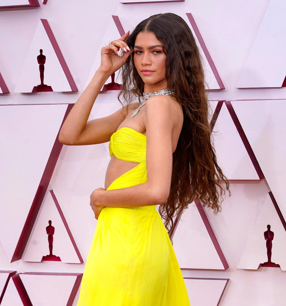 """DeBolt loves this shade on Zendaya. """"This look is so youthful and combined with her natural texture looks so modern,"""" he says. """"This look is perfect for someone who wants to highlight their hair one time per year or never feel like they have outgrowth."""" To get the look, DeBolt says to ask for barely there, hand-painted highlights."""