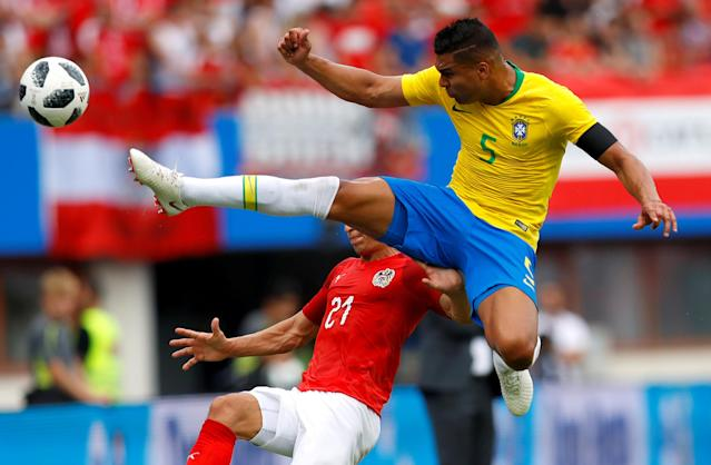 Soccer Football - International Friendly - Austria vs Brazil - Ernst-Happel-Stadion, Vienna, Austria - June 10, 2018 Brazil's Casemiro in action with Austria's Stefan Lainer REUTERS/Leonhard Foeger TPX IMAGES OF THE DAY