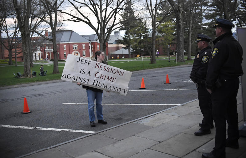 A protester speaks to police outside Johnson Chapel, where former attorney general Jeff Sessions is speaking, at Amherst College in Amherst, Mass., Wednesday, April 24, 2019. (AP Photo/Jessica Hill)