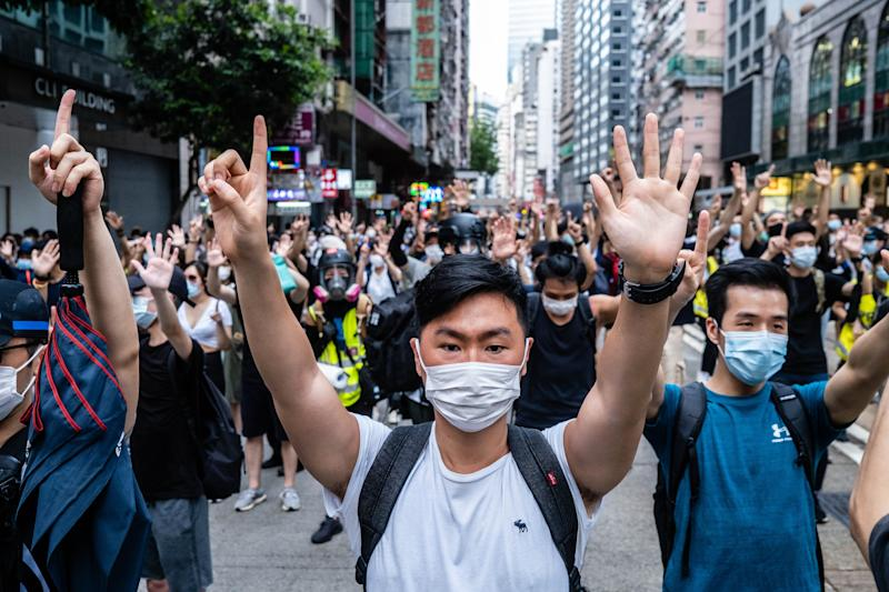 HONG KONG, CHINA - 2020/07/01: Protesters making gestures of 1 and 5 fingers, symbolising the five demands of the protest movement during the demonstration. Following the passing of the National Security Law that would tighten on freedom of expression, Hong Kong protesters marched on the streets to demonstrate. Protesters chanted slogans, sang songs, and obstructed roads. Later, riot police officers arrested several protesters using paintballs and pepper spray. (Photo by Willie Siau/SOPA Images/LightRocket via Getty Images)
