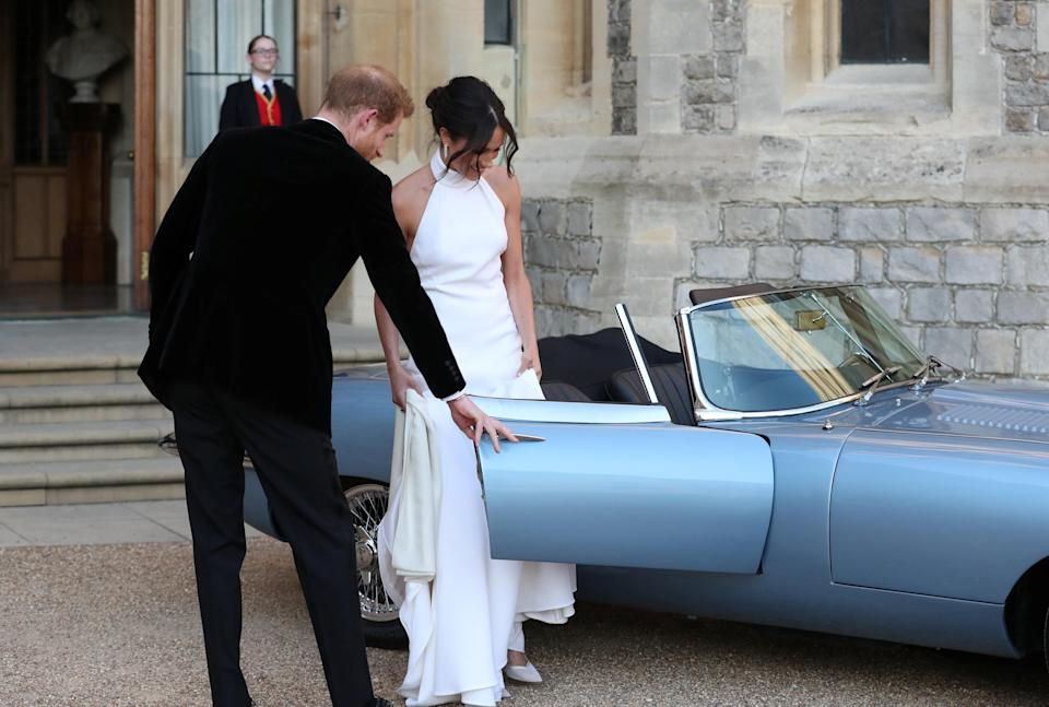 <em>Newlyweds – Harry drove his new wife to the evening reception in a silver blue classic convertible Jaguar E-Type Concept Zero which has been converted to electric power (Picture: Reuters)</em>