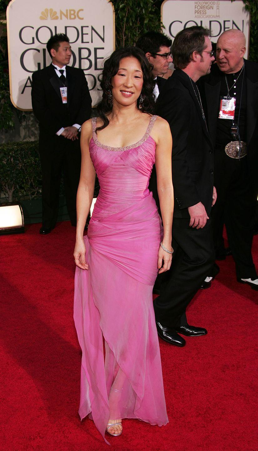 <p>Sandra Oh was pretty in pink, wearing this fitted number to the awards in 2005.</p>