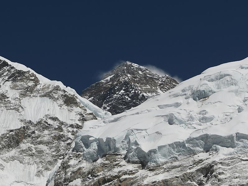 Steve Plain summited Everest in the early hours of Monday, 117 days after he reached the peak of Mount Vinson -- the highest mountain in Antarctica -- breaking the previous speed record for the seven summits by nine days. (AFP Photo/PRAKASH MATHEMA)
