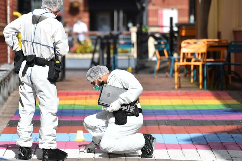 Police forensic officers in Hurst Walk in Birmingham after a number of people were stabbed (PA)