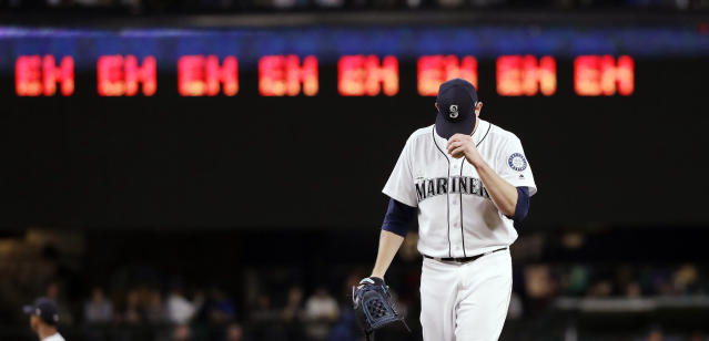 "Seattle Mariners starting pitcher James Paxton gets ready for the next batter after striking out an Oakland Athletics player as a line of ""eh's,"" a nod to Paxton's Canadian heritage and his strikeout count, appears on a scoreboard during the seventh inning of a baseball game Wednesday, May 2, 2018, in Seattle. (AP Photo/Elaine Thompson)"