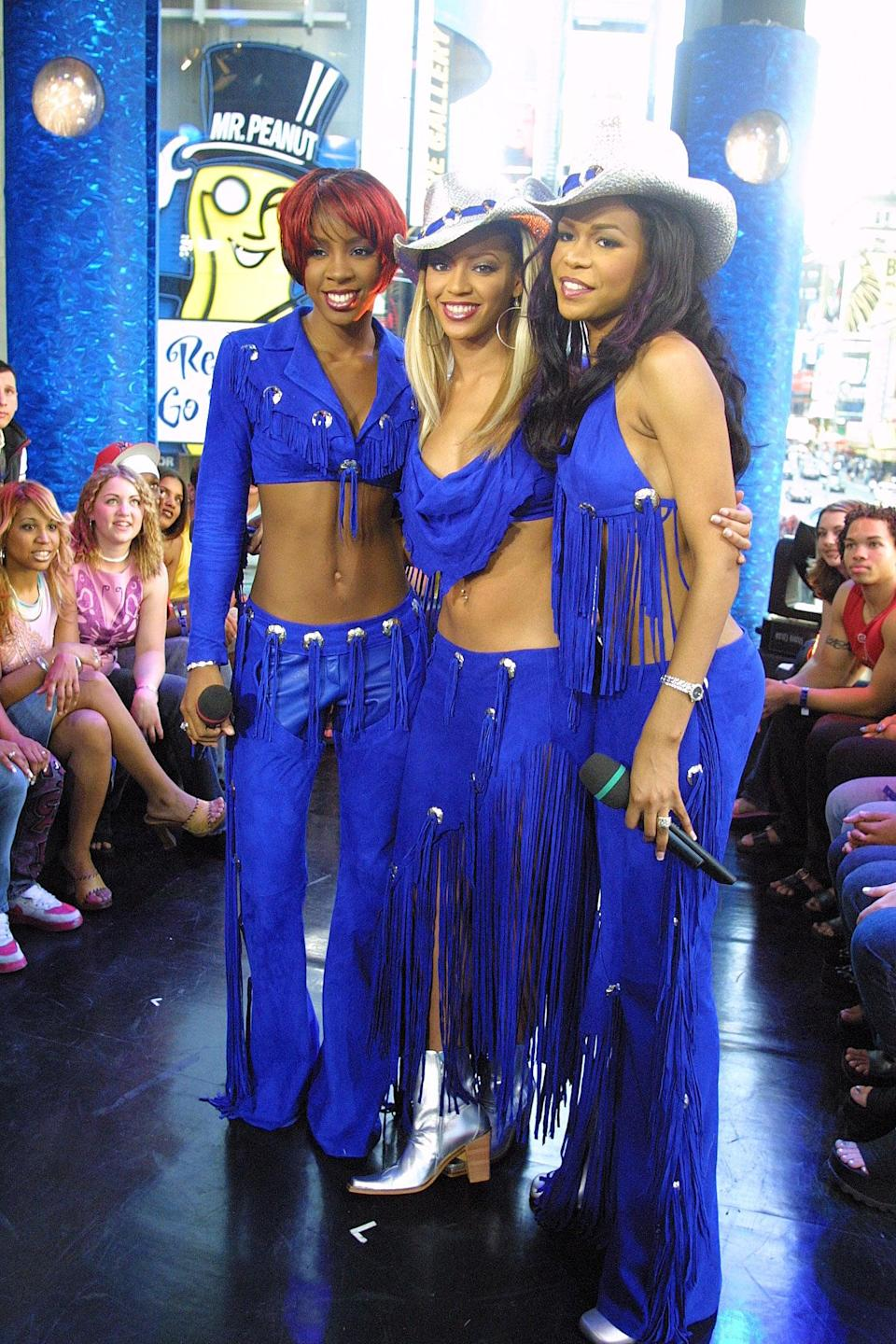 <p>Destiny's Child made a <b>TRL</b> appearance with matching blue outfits in 2001.</p>