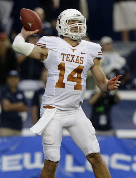 Texas quarterback David Ash (14) passes the ball in the first quarter during an NCAA college football game against Brigham Young Saturday, Sept. 7, 2013, in Provo, Utah. (AP Photo/Rick Bowmer)