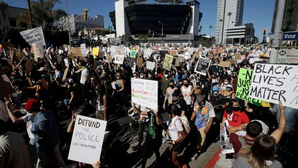 PHOTO: Demonstrators March Sunday June, 7, 2020 in the Hollywood area of Los Angeles, during a protest over the death of George Floyd who died May 25 after he was restrained by Minneapolis police. (Marcio Jose Sanchez/AP Photo)