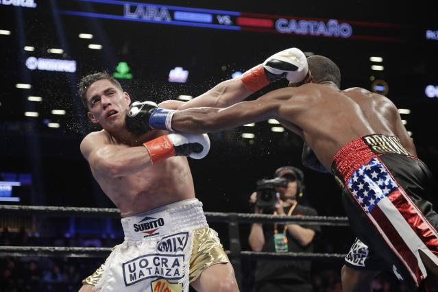 Cuba's Erislandy Lara, right, punches Argentina's Brian Carlos Castano during the ninth round of a WBA super welterweight championship boxing match Saturday, March 2, 2019, in New York. (AP Photo/Frank Franklin II)