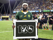 South Africa's captain Siya Kolisi holds a piece of memorabilia commemorating the 100th test against the All Blacks following their Rugby Championship test match in Townsville, Australia, Saturday, Sept. 25, 2021. (AP Photo/Tertius Pickard)
