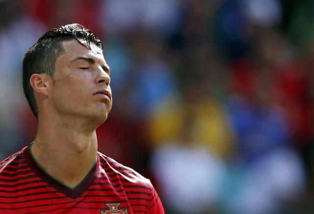 Portugal's Cristiano Ronaldo reacts during their 2014 World Cup Group G soccer match against Germany at the Fonte Nova arena in Salvador June 16, 2014. REUTERS/Marcos Brindicci (BRAZIL - Tags: SOCCER SPORT WORLD CUP)
