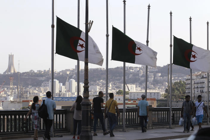 Algerian flags fly at half-staff along the seaside walk in Algiers, Saturday, Sept. 18, 2021. Algeria's leader declared a three-day period of mourning starting Saturday for former President Abdelaziz Bouteflika, whose 20-year-long rule, riddled with corruption, ended in disgrace as he was pushed from power amid huge street protests when he decided to seek a new term. Bouteflika, who had been ailing since a stroke in 2013, died Friday at 84. (AP Photo/Fateh Guidoum)