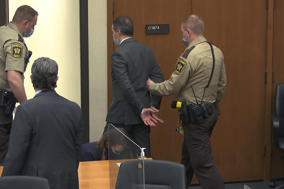 In this image from video, former Minneapolis police officer Derek Chauvin is taken into custody as his attorney Eric Nelson, left, watches, after his bail was revoked after he was found guilty on all three counts in his trial for the 2020 death of George Floyd, Tuesday, April 20, 2021, at the Hennepin County Courthouse in Minneapolis. (Court TV via AP, Pool)