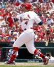St. Louis Cardinals' Yadier Molina watches his two-run home run during the first inning of a baseball game against the Kansas City Royals on Saturday, June 16, 2012, in St. Louis. (AP Photo/Jeff Roberson)