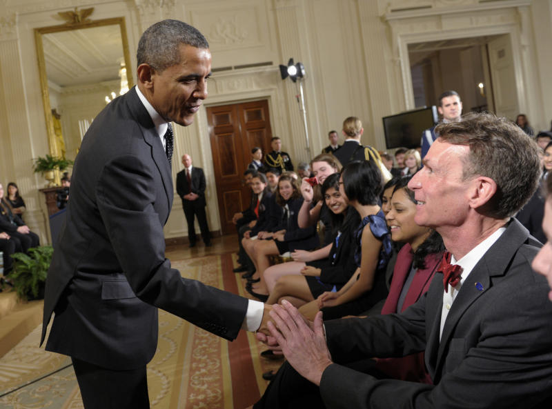 "FILE - In this Feb. 7, 2012, file photo, President Barack Obama shakes hands with Bill Nye during an event in the East Room of the White House in Washington. Nye, a mechanical engineer and star of the popular 1990s Television show ""Bill Nye The Science Guy,"" recently waded into the evolution debate with an online video urging parents not to pass their religious-based doubts about evolution on to their children. (AP Photo/Susan Walsh, File)"