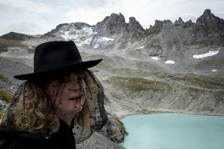 """The new study on Switzerland's melting glaciers comes less than a month aftera """"funeral march"""" was held on a steep mountainside to mark the disappearance of the Pizol glacier"""