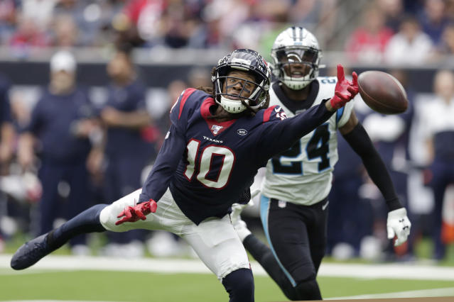 Houston Texans wide receiver DeAndre Hopkins (10) misses a pass as Carolina Panthers cornerback James Bradberry (24) defend the play during the second half of an NFL football game Sunday, Sept. 29, 2019, in Houston. (AP Photo/Michael Wyke)