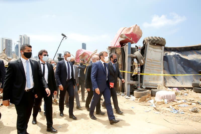 FILE PHOTO: French President Emmanuel Macron visits the devastated site of the explosion at the port of Beirut