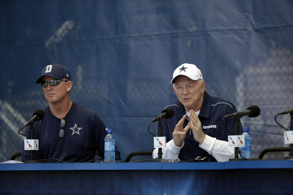 "Dallas Cowboys owner Jerry Jones, right, and head coach Jason Garrett address the media during the ""state of the team"" press conference at the start of the Dallas Cowboys NFL football training camp Friday, July 26, 2019, in Oxnard, Calif. (AP Photo/Marcio Jose Sanchez)"