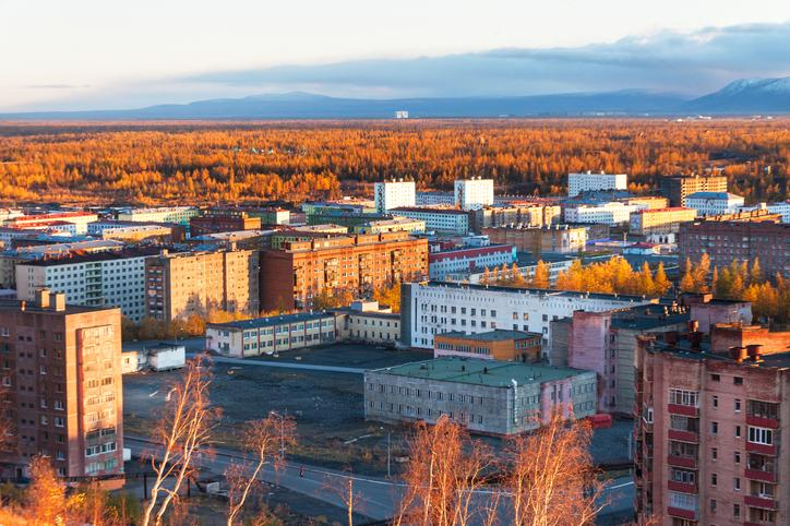 The residential area of the industrial city in the Arctic Circle. Sunset.