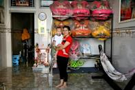 """I am proud to be the person who has inspired other girls,"" says lion dancer Le Yen Quyen whose baby daughter accompanies her to practices"