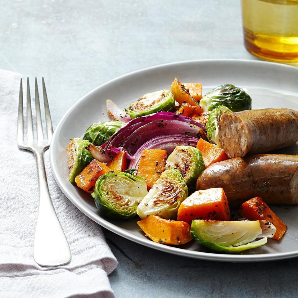 <p>In this sheet-pan dinner recipe, butternut squash, Brussels sprouts, garlic and sausage all roast on one pan. Pick whatever variety of chicken sausage you prefer but we're partial to the flavor of chicken-apple in this healthy dinner recipe. Serve with crusty bread and a dollop of whole-grain mustard.</p>