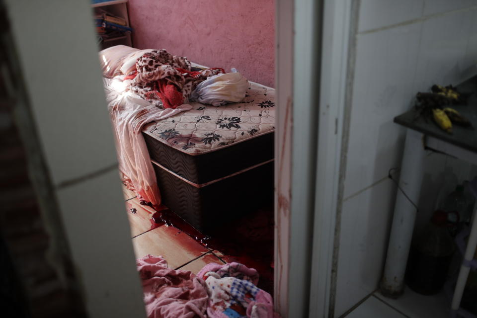 Blood covers the floor and a bed inside a home during a police operation targeting drug traffickers in the Jacarezinho favela of Rio de Janeiro, Brazil, Thursday, May 6, 2021. At least 25 people died including one police officer and 24 suspects, according to the press office of Rio's civil police. (AP Photo/Silvia Izquierdo)