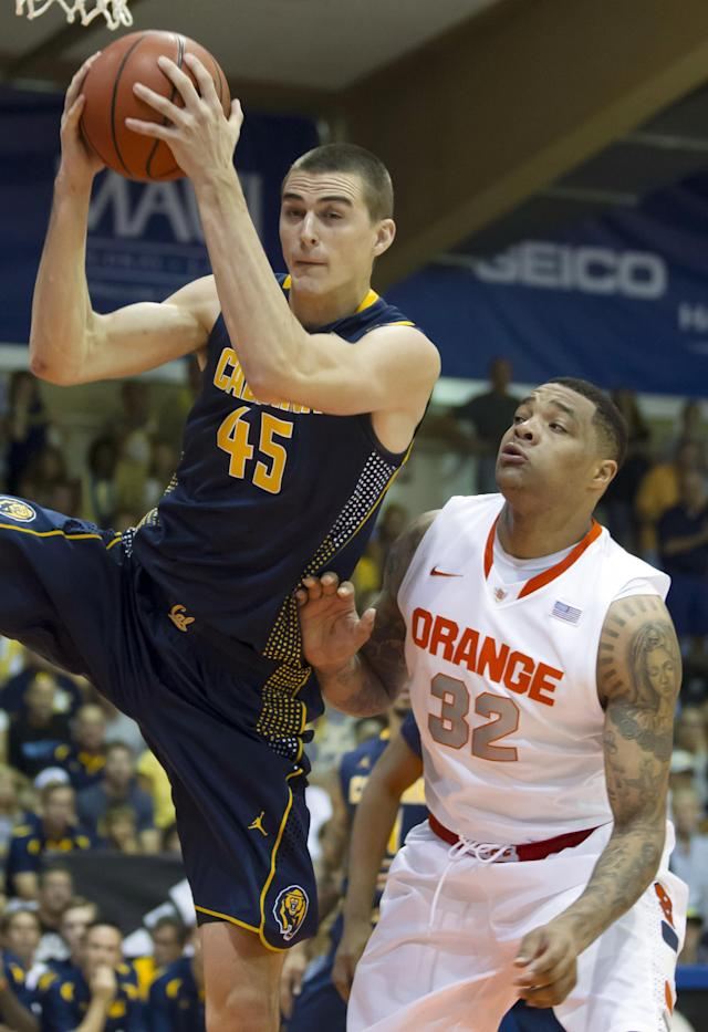 California forward David Kravish (45) grabs a rebound in front of Syracuse forward DaJuan Coleman (32) during the first half of an NCAA college basketball game at the Maui Invitational on Tuesday, Nov. 26, 2013, in Lahaina, Hawaii. (AP Photo/Eugene Tanner)