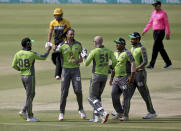 Lahore Qalandars, David Wiese, second left, celebrates with teammates after taking the wicket of Peshawar Zalmi Shoaib Malik during a Pakistan Super League T20 cricket match between Peshawar Zalmi and Lahore Qalandars at the National Stadium, in Karachi, Pakistan, Sunday, Feb. 21 2021. (AP Photo/Fareed Khan)