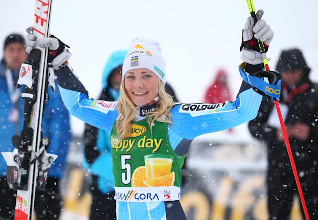 Frida Hansdotter of Swden celebrates in the finish area after winning an alpine skiing women's Slalom in Kranjska Gora, Slovenia, Sunday, Feb. 2, 2014. (AP Photo/Giovanni Auletta)