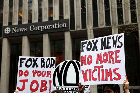 Protestors from the National Organization for Women of New York (NOW-NYC) hold a protest in front of Fox News Channel and the News Corporation Headquarters, following the firing of Bill O'Reilly, in New York City, U.S., April 20, 2017. REUTERS/Shannon Stapleton
