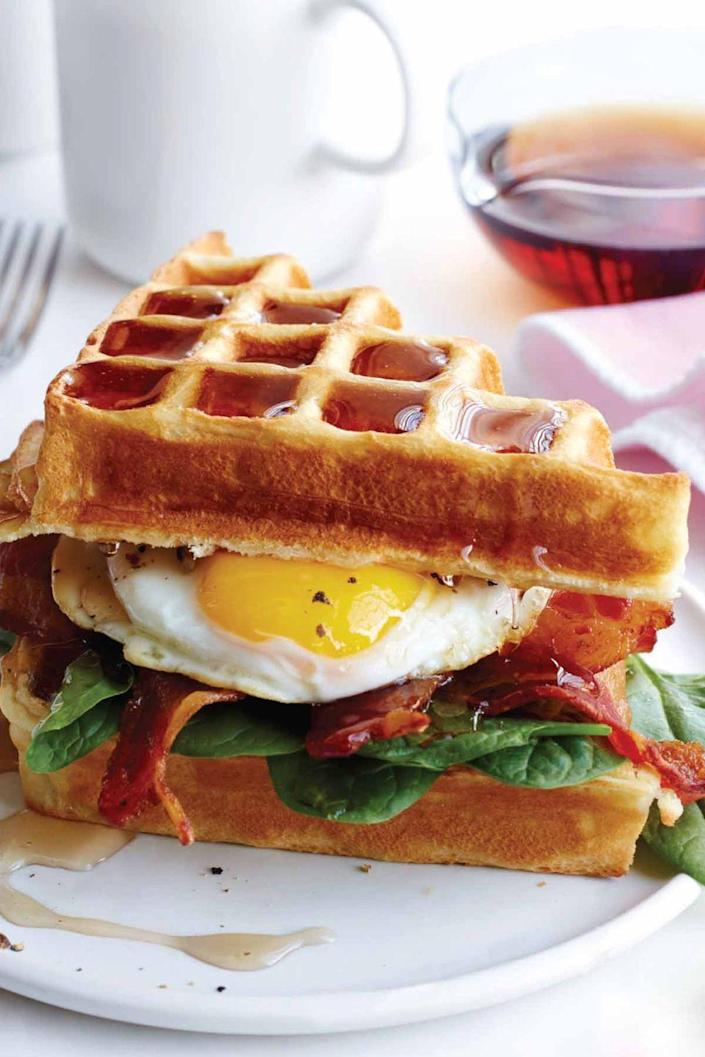 """<p>Waffles <em>or </em>eggs? Why choose when you can have both?! This is the perfect brunch sandwich.</p><p><a href=""""https://www.womansday.com/food-recipes/recipes/a50558/buttermilk-waffle-bacon-egg-sandwich-recipe-wdy0615/"""" rel=""""nofollow noopener"""" target=""""_blank"""" data-ylk=""""slk:Get the Buttermilk Waffle, Bacon and Egg Sandwich recipe."""" class=""""link rapid-noclick-resp""""><strong><em>Get the Buttermilk Waffle, Bacon and Egg Sandwich recipe.</em></strong></a></p>"""