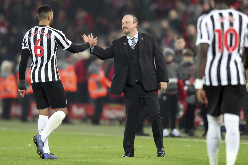 Newcastle coach Rafael Benitez, right, greets Newcastle's Mohamed Diame at the end of the English Premier League soccer match between Liverpool and Newcastle at Anfield Stadium, in Liverpool, England, Wednesday, Dec. 26, 2018. (AP Photo/Jon Super)
