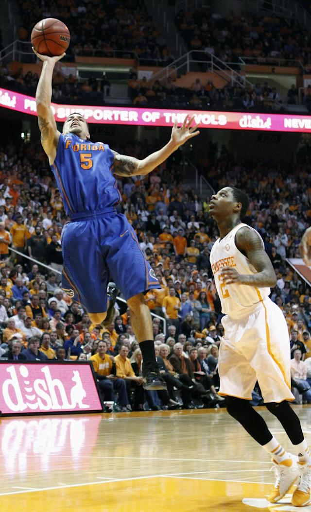 Florida guard Scottie Wilbekin (5) puts up a shot past Tennessee guard Antonio Barton (2) in the second half of an NCAA college basketball game Tuesday, Feb. 11, 2014, in Knoxville, Tenn. Florida won 67-58. (AP Photo/Wade Payne)