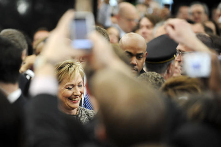 <p>Secretary of State Hillary Clinton, left, greets employees as she arrives for her first day at the State Department in Washington, D.C., on Jan. 22, 2009. (Photo: Jonathan Ernst/Reuters)</p>