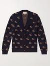 """<p><strong>Gucci</strong></p><p>mrporter.com</p><p><strong>$1200.00</strong></p><p><a href=""""https://go.skimresources.com?id=74968X1525079&xs=1&url=https%3A%2F%2Fwww.mrporter.com%2Fen-us%2Fmens%2Fproduct%2Fgucci%2Fclothing%2Fcardigans%2Flogo-jacquard-wool-cardigan%2F2009602945596"""" rel=""""nofollow noopener"""" target=""""_blank"""" data-ylk=""""slk:Shop Now"""" class=""""link rapid-noclick-resp"""">Shop Now</a></p><p>Gucci's logo sweater is not your average dad's cardigan, making it a great addition to his knitwear collection. </p>"""