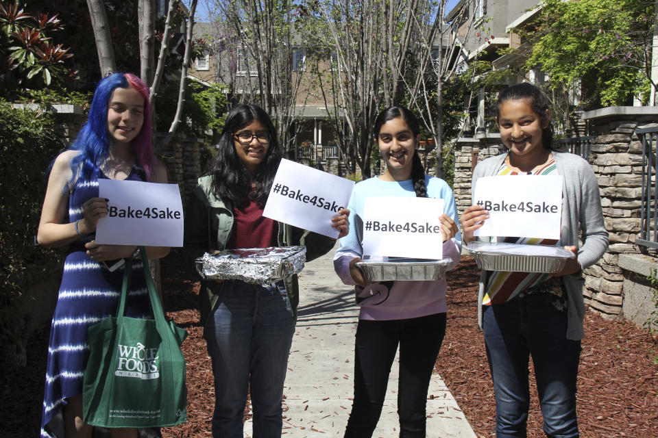 From left, Caitlin Starmer, Anika Garikipati, Japleen Kaur and Vedika Jawa pose with desserts they baked for residents of a homeless shelter in Fremont, Calif., on April 1, 2018. Jawa, a high school junior, distributes sweets to 15 shelters through a nonprofit she started when she was 13. (Shalesh Jawa via AP)