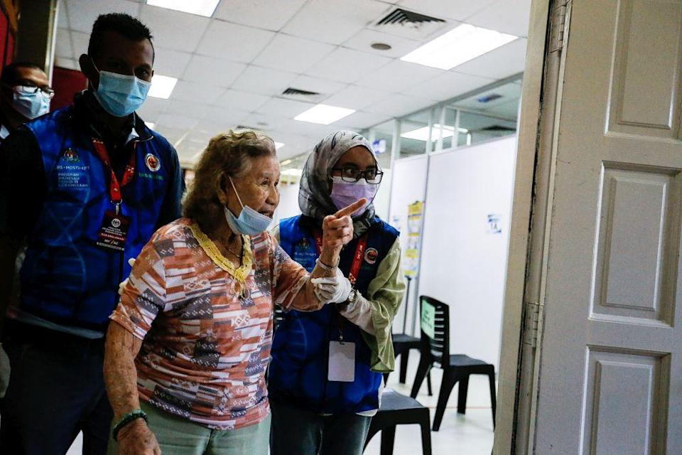 A senior citizen arrives for her Covid-19 shot under phase two of Penang's immunisation drive at the Caring Society Complex in George Town April 19, 2021. — Picture by Sayuti Zainudin