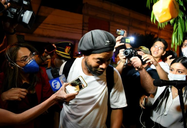Retired Brazilian football great Ronaldinho arrives at a hotel in Asuncion, Paraguay, where he and his brother will serve house arrest while they await trial