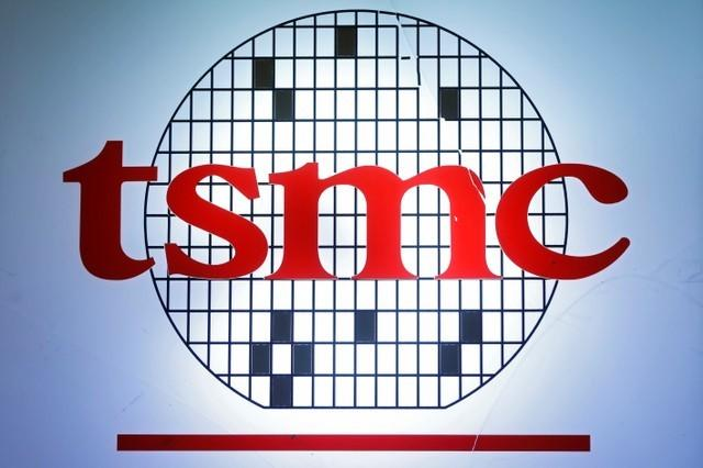 The logo of Taiwan Semiconductor Manufacturing Company (TSMC) is seen during an investors' conference in Taipei