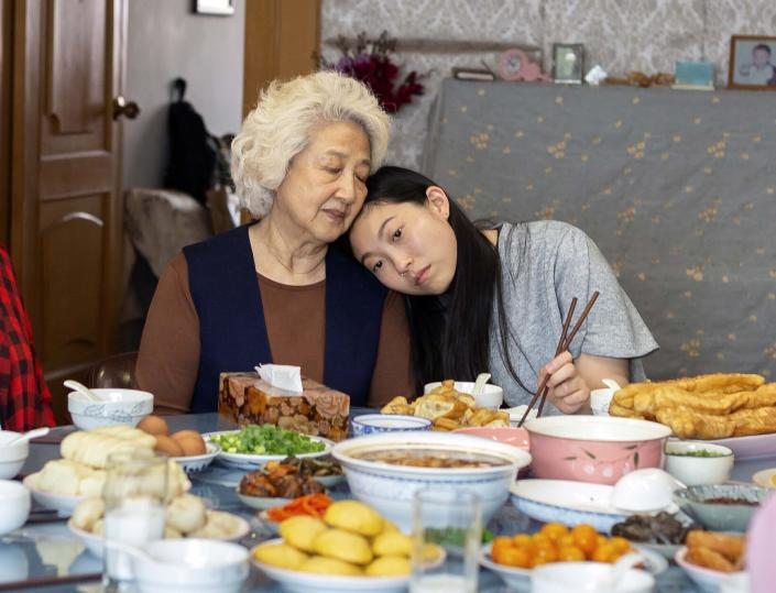 """This image released by A24 films shows Zhao Shuzhen, left, and Awkwafina in a scene from """"The Farewell."""" Awkwafina won a Globe earlier this month for """"The Farewell,"""" it was a proud moment for Asian Americans in Hollywood _ the first win by an actress of Asian descent in the lead category. There was much hope for an Oscar nod, but alas, it was not to be; in fact the much-admired film was shut out. (Casi Moss/A24 via AP)"""