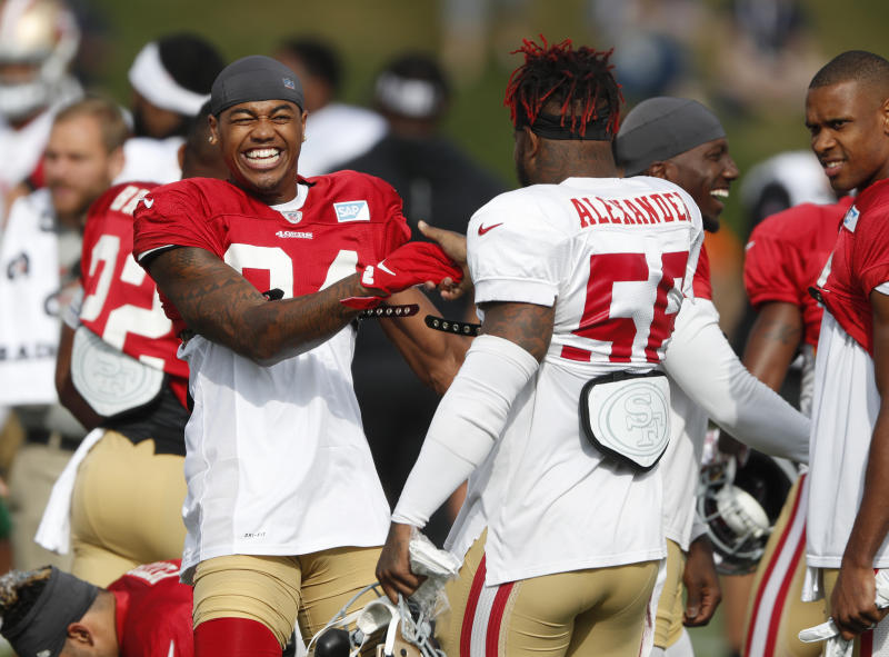 San Francisco 49ers wide receiver Kendrick Bourne, left, jokes with middle linebacker Kwon Alexander during a combined NFL football training camp with the Denver Broncos at the Broncos' headquarters Friday, Aug. 16, 2019, in Englewood, Colo. (AP Photo/David Zalubowski)