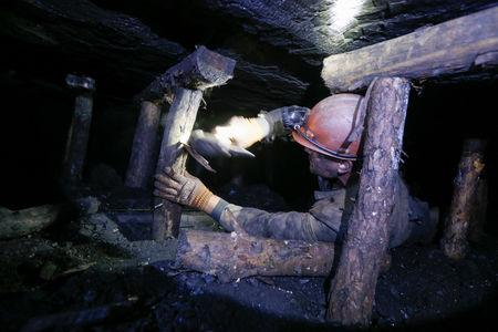 A miner works inside the Novovolynska-9 coal mine in Novovolynsk, Ukraine August 2, 2018. Picture taken August 2, 2018.  REUTERS/Valentyn Ogirenko
