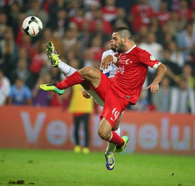 Turkey's Arda Turan, right, and Jeremain Lens of Netherlands fight for the ball during their World Cup Group D qualifying soccer match at Sukru Saracoglu Stadium in Istanbul, Turkey, Tuesday, Oct. 15, 2013. (AP Photo)