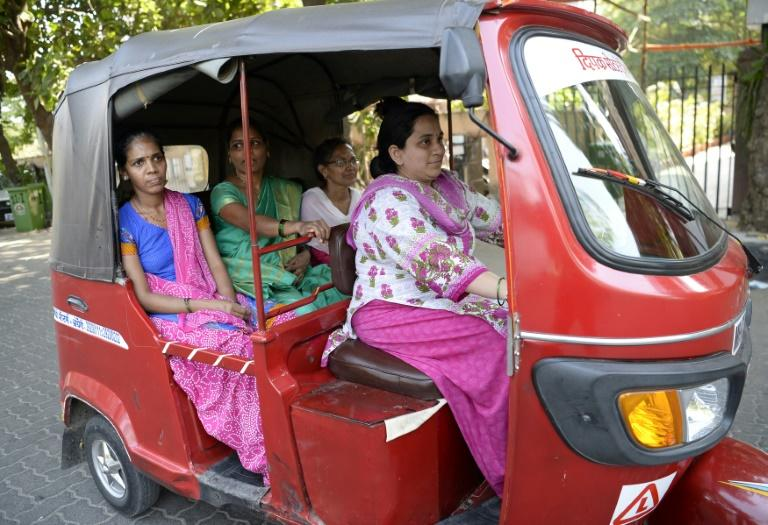 """I couldn't even ride a bicycle but today I can drive an auto rickshaw. I'm independent and it makes me happy,"" one female driver says after taking part in a scheme to encourage more women taxi drivers in Mumbai"